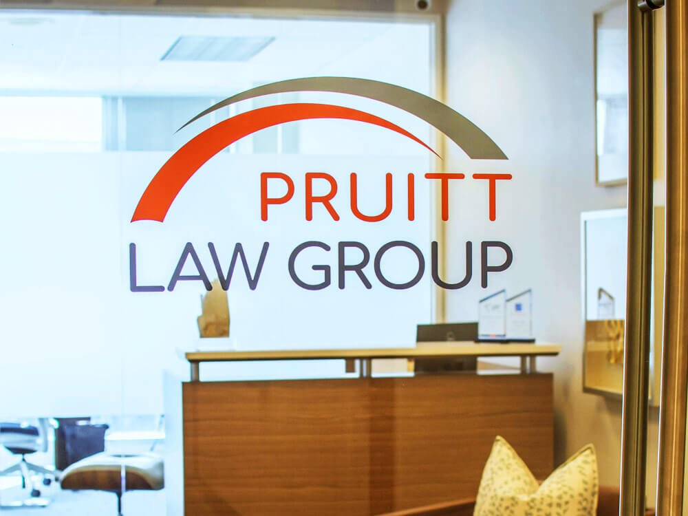 Front desk of the firm's office with firm logo: Pruitt Law Group